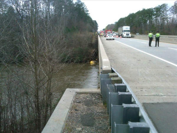 A truck plunged off the side of a bridge into the Haw River in Chatham County. <span class=meta>(WTVD Photo&#47; Shae Crisson)</span>