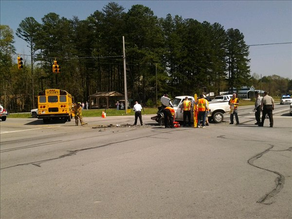 The driver of a pickup was injured Wednesday afternoon when he broadsided an empty activity bus at Durham Rd. and Helena Moriah Rd in east of the Person County Airport near Timberlake. <span class=meta>(WTVD Photo&#47; Jim Shumacher)</span>