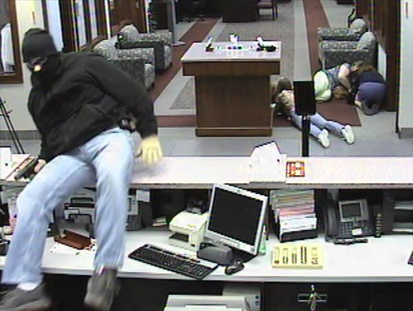Police say this man robbed a BB&#38;T bank in Apex Thursday. <span class=meta>(Surveillance Photo)</span>
