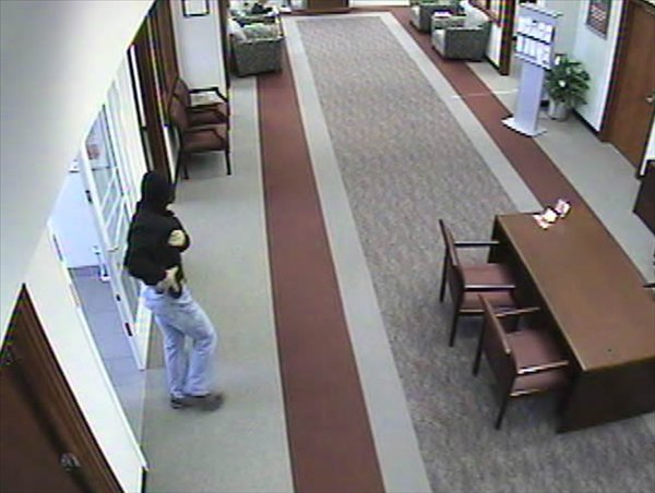 "<div class=""meta image-caption""><div class=""origin-logo origin-image ""><span></span></div><span class=""caption-text"">Police say this man robbed a BB&T bank in Apex Thursday. (Surveillance Photo)</span></div>"
