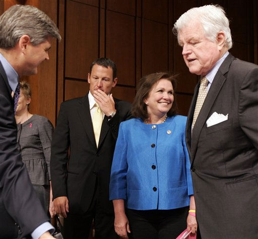 Chairman of the Senate Health, Education, Labor and Pensions Committee Sen. Edward Kennedy, D-Mass., right, arrives for a hearing with Elizabeth Edwards, wife of former Democratic presidential hopeful Sen. John Edwards, D-N.C., cancer survivor and seven-time Tour de France winner Lance Armstrong, and entrepreneur Steve Case, left, for a hearing on the challenges and opportunities for fighting cancer, Thursday, May 8, 2008 on Capitol Hill in Washington.  <span class=meta>(AP Photo&#47; Susan Walsh)</span>