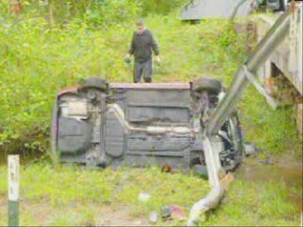 "<div class=""meta image-caption""><div class=""origin-logo origin-image ""><span></span></div><span class=""caption-text"">A woman survived a frightening crash along Mangum Dairy Rd. just south of the Granville County line Friday morning. Troopers said she was going too fast on a wet road when her car went off a bridge and landed in shallow water below. She was taken to the hospital as a precaution. (WTVD Photo/ Mat Mendez)</span></div>"