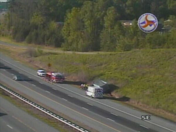 "<div class=""meta ""><span class=""caption-text "">A wreck involving a dump truck shut down lanes of  U.S. 70 East near Exit 286 to Cheek Road in Durham. (NCDOT Photo)</span></div>"