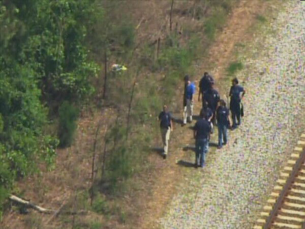 Law enforcement officers search on foot and by air for Bordeaux. <span class=meta>(WTVD Photo)</span>