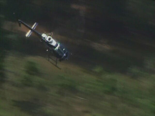 "<div class=""meta ""><span class=""caption-text "">Law enforcement officers search on foot and by air for Bordeaux. (WTVD Photo)</span></div>"