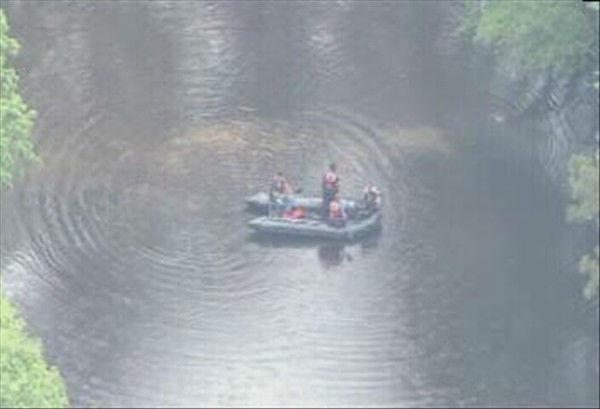 Police search a pond near the area where Bordeaux was last seen.   <span class=meta>(WTVD Photo)</span>