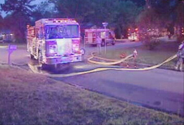 Firefighters rushed to a home in southeast Raleigh Friday morning after a 911 caller reported flames shooting from a window. <span class=meta>(WTVD Photo&#47; Jeff Hinkle)</span>
