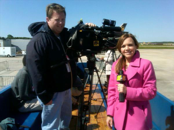 "<div class=""meta ""><span class=""caption-text "">Shae Crisson and Photojournalist Paul Furr await the President's arrival at RDU. (WTVD Photo)</span></div>"