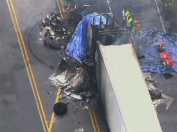 "<div class=""meta image-caption""><div class=""origin-logo origin-image ""><span></span></div><span class=""caption-text"">Two trucks burst into flames after one rear-ended the other on Hwy 258 south of Kinston. (WTVD Photo)</span></div>"