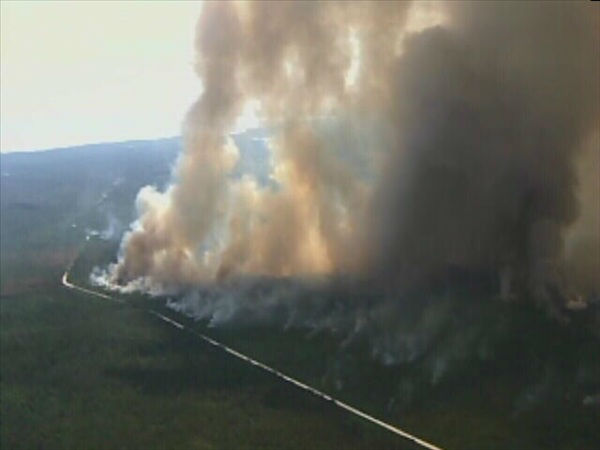 Pictures from Chopper 11 show a huge wildfire burning in the Croatan National Forest near New Bern. <span class=meta>(WTVD Photo)</span>