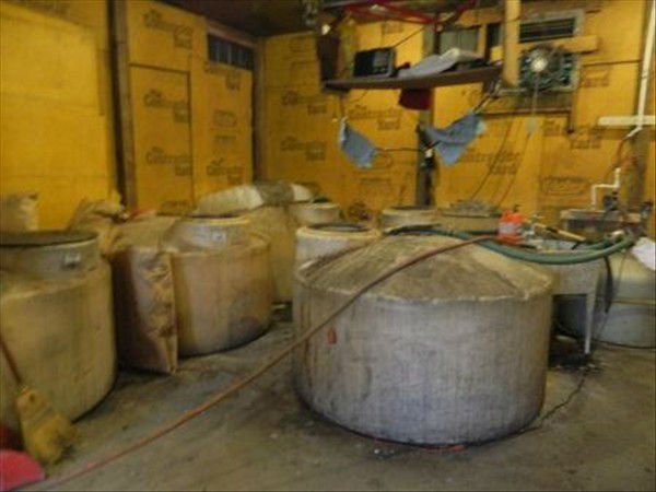 "<div class=""meta image-caption""><div class=""origin-logo origin-image ""><span></span></div><span class=""caption-text"">The Sampson County Sheriff's Office said Wednesday that it and agents with the NC Alcohol Law Enforcement Division, and NC State Highway Patrol, discovered a large moonshine operation in a metal building on Mt. Elam Church Road near the intersection of Old Cotton Gin Road. Samuel Scott Byrd, age 38, of Benson, NC, was charged with misdemeanor selling and manufacture of non-tax-paid alcohol. Agents destroyed the still and seized 24 gallons of moonshine (Photo/Sampson County Sheriff's Office Photo)</span></div>"