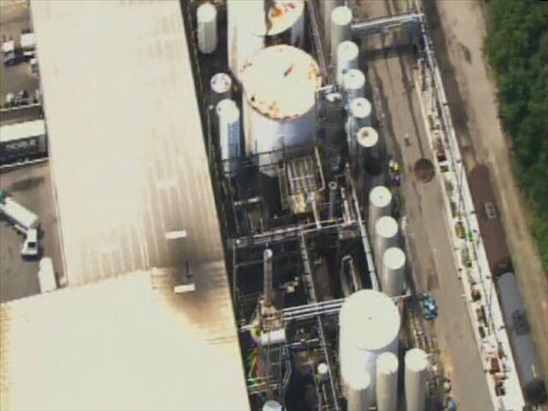 "<div class=""meta ""><span class=""caption-text "">Two people were hurt when the top blew off a tank at Noble Oil Services on Clyde Rhyne Drive in Sanford. (WTVD Photo)</span></div>"