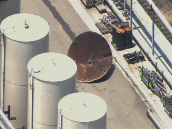 "<div class=""meta image-caption""><div class=""origin-logo origin-image ""><span></span></div><span class=""caption-text"">Two people were hurt when the top blew off a tank at Noble Oil Services on Clyde Rhyne Drive in Sanford. (WTVD Photo)</span></div>"
