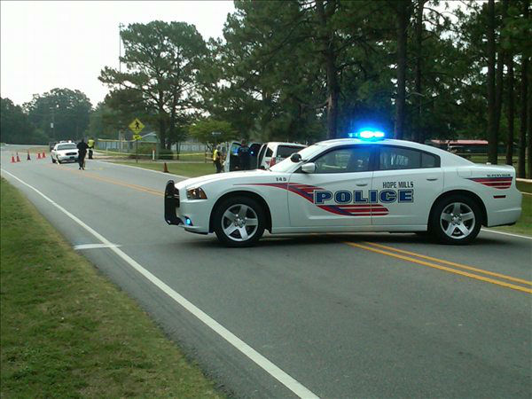 "<div class=""meta ""><span class=""caption-text "">Police investigate in Hope Mills  (WTVD Photo/ Lou Guilette)</span></div>"