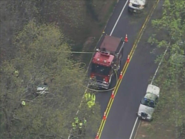 Police investigate at the scene of the crash Wednesday afternoon. <span class=meta>(WTVD Photo&#47; Chopper 11 HD)</span>