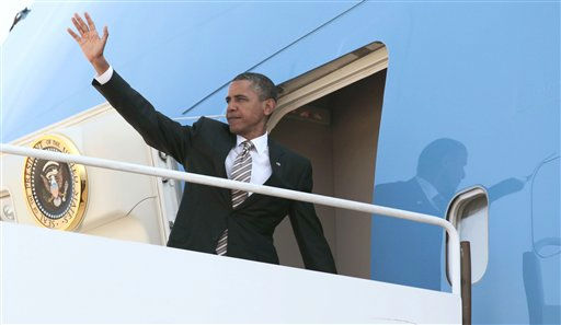 President Barack Obama waves prior to boarding Air Force One before his departure from Andrews Air Force Base, Md., Wednesday, Sept., 14, 2011, enroute to North Carolina .  <span class=meta>(AP Photo&#47; Pablo Martinez Monsivais)</span>