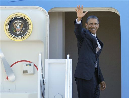 President Barack Obama waves as he boards Air Force One at Andrews Air Force Base, Md., Wednesday, Sept. 14, 2011.  <span class=meta>(AP Photo&#47; Cliff Owen)</span>