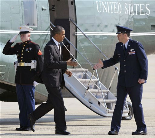President Barack Obama is greeted by Air Force Col. Greg Urtso, 11th Wing commander, as he arrives at Andrews Air Force Base, Md., Wednesday, Sept. 14, 2011.  <span class=meta>(AP Photo&#47; Cliff Owen)</span>