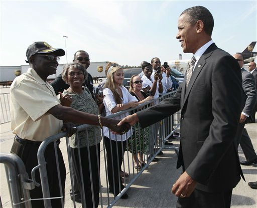 President Barack Obama greets people on that tarmac upon his arrival at Raleigh-Durham International Airport in Morrisville, N.C., Wednesday, Sept. 14, 2011.   <span class=meta>(AP Photo&#47; Pablo Martinez Monsivais)</span>