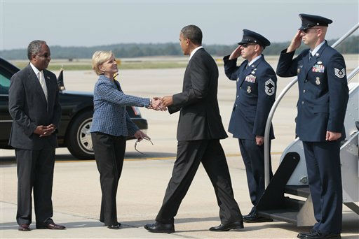 "<div class=""meta image-caption""><div class=""origin-logo origin-image ""><span></span></div><span class=""caption-text"">President Barack Obama is greeted by North Carolina Gov. Bev Perdue upon his arrival at Raleigh-Durham International Airport in Morrisville, N.C., Wednesday, Sept., 14, 2011.  At left is  Durham, N.C. Mayor William (Bill) Bell. (AP Photo/ Pablo Martinez Monsivais)</span></div>"