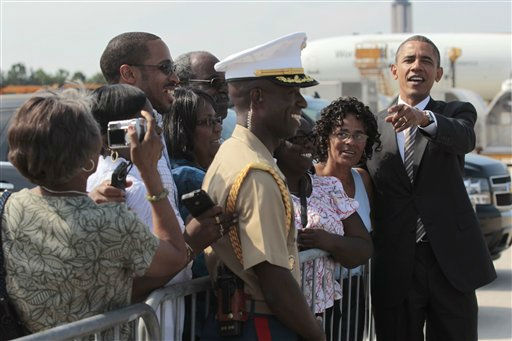 President Barack Obama poses for a group photo on the tarmac upon his arrival at Raleigh-Durham International Airport in Morrisville, N.C., Wednesday, Sept.,14, 2011.  <span class=meta>(AP Photo&#47; Pablo Martinez Monsivais)</span>