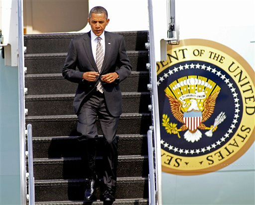 President Barack Obama jogs down the ramp after arriving at Raleigh Durham International Airport in Morrisville, N.C., Wednesday, Sept. 14, 2011, prior to speech about the American Jobs Act.  <span class=meta>(AP Photo&#47; Jim R. Bounds)</span>