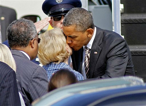 President Barack Obama kisses North Carolina Gov. Beverly  Perdue after arriving at Raleigh Durham International Airport Raleigh Durham International Airport in Morrisville, N.C., Wednesday, Sept. 14, 2011. At left is Durham, N.C. Mayor William Bell.  <span class=meta>(AP Photo&#47; Jim R. Bounds)</span>