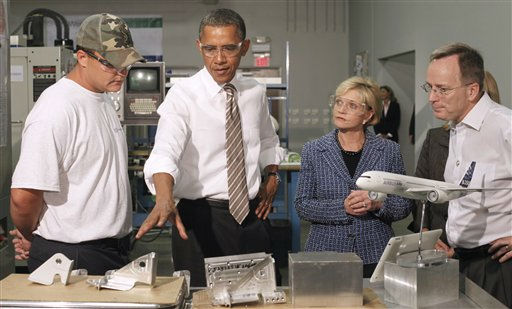 "<div class=""meta image-caption""><div class=""origin-logo origin-image ""><span></span></div><span class=""caption-text"">President Barack Obama points to manufactured parts used in commercial aircrafts during his tour of the WestStar Precision Facility, Apex, NC, Wednesday, Sept., 14, 2011. From left are, employee Jodi Park, North Carolina Gov. Bev Perdue, and owner Ervin Portman.  (AP Photo/ Pablo Martinez Monsivais)</span></div>"