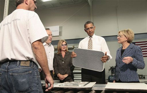 President Barack Obama holds up a food tray used in commercial aircrafts during his tour of the WestStar Precision Facility, Apex, NC, Wednesday, Sept., 14, 2011. With Obama are from left, employee Barry Blackman, co-owners, Ervin and Susan Portman, and  North Carolina Gov. Bev Perdue.  <span class=meta>(AP Photo&#47; Pablo Martinez Monsivais)</span>