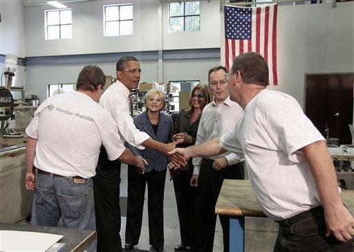 President Barack Obama greets employees during his tour of the WestStar Precision Facility, Apex, N.C., Wednesday, Sept., 14, 2011. With Obama are North Carolina Gov. Bev Perdue, third from left, and co-owners Susan and Ervin Portman.  <span class=meta>(AP Photo&#47; Pablo Martinez Monsivais)</span>