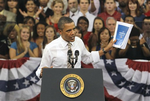 President Barack Obama holds up the American Jobs Act as he speaks at North Carolina State University in Raleigh, N.C., Wednesday, Sept. 14, 2011.  <span class=meta>(AP Photo&#47; Gerry Broome)</span>