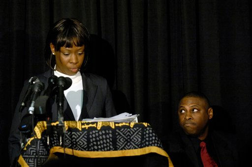 Crystal Mangum addresses the media during a press conference on the release of her book &#34;The Last Dance for Grace: The Crystal Mangum Story,&#34;  while her publisher and co-author Vincent Clark watches in Durham, N.C., on Thursday, Oct. 23, 2008.  <span class=meta>(AP Photo&#47; Sara D. Davis)</span>