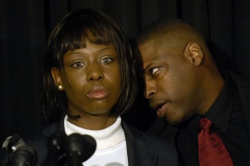 Crystal Mangum addresses the media during a press conference on the release of her book &#34;The Last Dance for Grace: The Crystal Mangum Story,&#34;  while her publisher and co-author Vincent Clark advises her in Durham, N.C., on Thursday, Oct. 23, 2008.  <span class=meta>(AP Photo&#47; Sara D. Davis)</span>