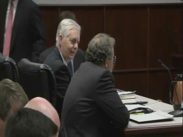 Former Governor Mike Easley speaks with his lawyers at a hearing in Raleigh. <span class=meta>(WTVD)</span>