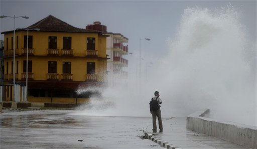 A man walks where a wave sprays the street as the outer bands of Hurricane Irene affect Baracoa, Cuba, Wednesday Aug. 24, 2011. &#40;AP Photo&#47;Javier Galeano&#41; <span class=meta>(AP Photo&#47; Javier Galeano)</span>