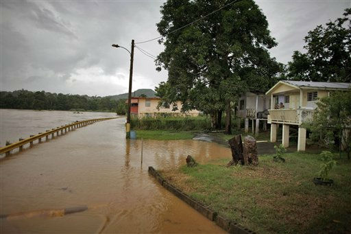 La Plata River overflows its banks the day after Hurricane Irene hit Toa Baja, Puerto Rico, Tuesday Aug. 23, 2011.  <span class=meta>(AP Photo&#47; Ricardo Arduengo)</span>