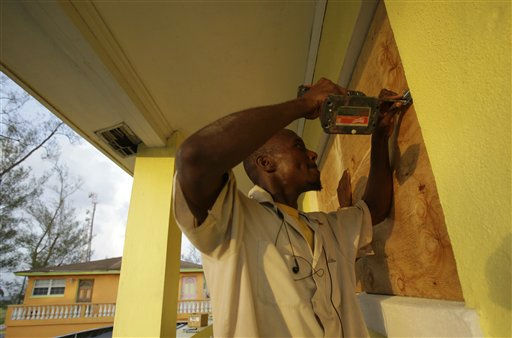 "<div class=""meta ""><span class=""caption-text "">Henry Paul boards up windows at a residence in preparation for Hurricane Irene in Nassau on New Providence Island in the Bahamas, Tuesday Aug. 23, 2011.  (AP Photo/ Lynne Sladky)</span></div>"