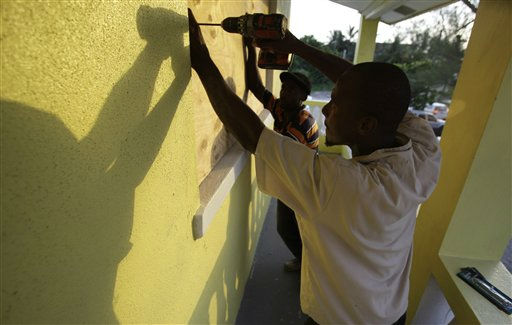 Henry Paul boards up windows at a residence in preparation for Hurricane Irene in Nassau on New Providence Island in the Bahamas, Tuesday Aug. 23, 2011.  <span class=meta>(AP Photo&#47; Lynne Sladky)</span>