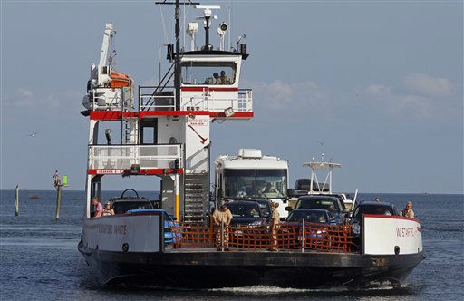 A ferry from Ocracoke Island arrives in Hatteras, N.C., Wednesday, Aug. 24, 2011.  <span class=meta>(AP Photo&#47; Gerry Broome)</span>