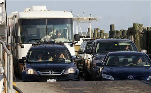 A ferry from from Ocracoke Island delivers passengers in Hatteras, N.C., Wednesday, Aug. 24, 2011. <span class=meta>(AP Photo&#47; Gerry Broome)</span>