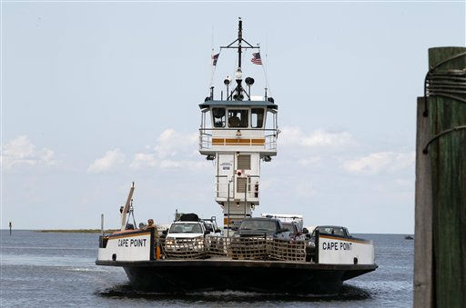 "<div class=""meta ""><span class=""caption-text "">People arrive at Cape Hatteras ferry terminal in Cape Hatteras. N.C. on Wednesday, Aug. 24,  2011.  (AP Photo/ Jose Luis Magana)</span></div>"