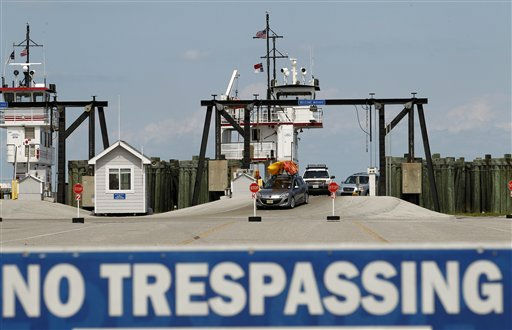 People from Ocracoke Island arrive at Cape Hatteras ferry terminal in preparation for Hurricane Irene in Cape Hatteras. N.C. on Wednesday, Aug. 24,  2011.  <span class=meta>(AP Photo&#47; Jose Luis Magana)</span>