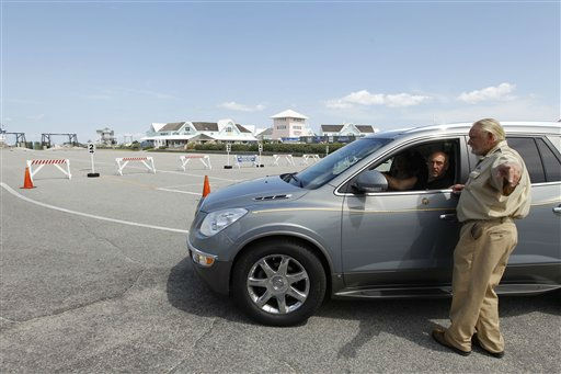"<div class=""meta ""><span class=""caption-text "">Ferry traffic controller Robert Harrelson turns around visitors who wanted to take the ferry to Ocracoke Island at Cape Hatteras ferry terminal, in preparation for Hurricane Irene in Cape Hatteras. N.C. on Wednesday, Aug. 24,  2011.  (AP Photo/ Jose Luis Magana)</span></div>"