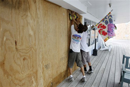 Jeremy Pickett and Thad Midgett boards the windows of a shopping store in Cape Hatteras, N.C. in preparation for Hurricane Irene on Wednesday, Aug. 24,  2011.  <span class=meta>(AP Photo)</span>