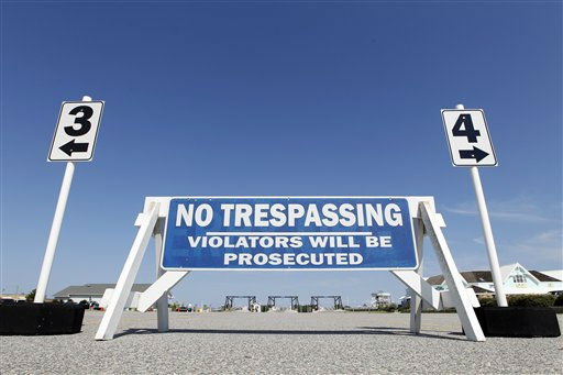"<div class=""meta ""><span class=""caption-text "">Ferry parking at Cape Hatteras is empty as evacuations from Ocracoke Island have begun Wednesday, Aug. 24, 2011 in preparation for Hurricane Irene in Cape Hatteras. N.C.   (AP Photo/ Jose Luis Magana)</span></div>"