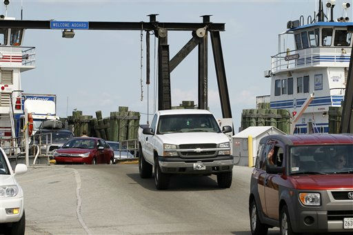 People who are evacuated from Ocracoke Island arrive at Cape Hatteras ferry terminal in preparation for Hurricane Irene in Cape Hatteras. N.C. on Wednesday, Aug. 24,  2011.   <span class=meta>(AP Photo&#47; Jose Luis Magana)</span>