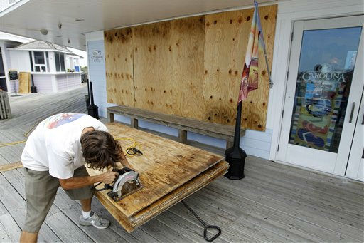Jeremy Pickett cut pieces of boards to protect the windows in a shopping store in Cape Hatteras in preparation for Hurricane Irene at Cape Hatteras. N.C. on Wednesday, Aug. 24,  2011.  <span class=meta>(AP Photo&#47; Jose Luis Magana)</span>