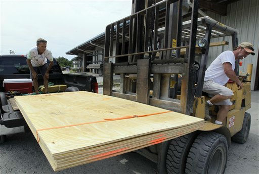 "<div class=""meta ""><span class=""caption-text "">Tim Waterfield, left, and Byron Wilson, an employee with Dare Building supply, load plywood into Waterfield's truck in Buxton, N.C., Wednesday, Aug. 24, 2011.  (AP Photo/ Gerry Broome)</span></div>"
