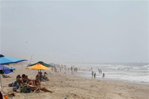 "<div class=""meta ""><span class=""caption-text "">Beachgoers sunbathe at Cape Hatteras. N.C. on Wednesday, Aug. 24,  2011.   (AP Photo/ Jose Luis Magana)</span></div>"