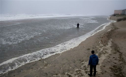 A reporter stands in the water in Nags Head, N.C., Saturday, Aug. 27, 2011, as the Hurricane Irene approaches. <span class=meta>(AP Photo&#47; Gerry Broome)</span>